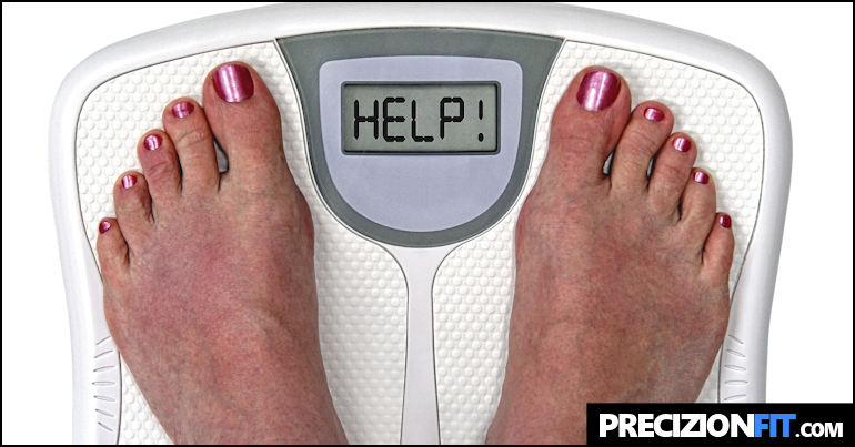 Woman on scale who is desperate to lose weight